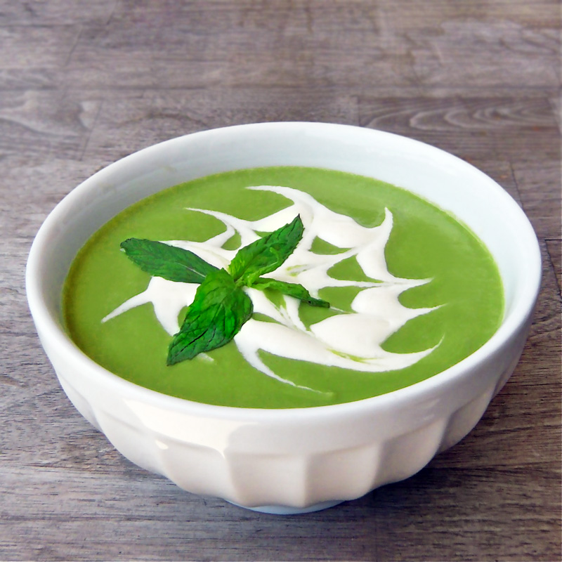 Chilled fresh pea soup with mint and soy yogurt.